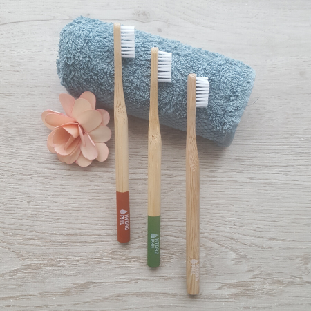 Bamboo toothbrushes red green natural